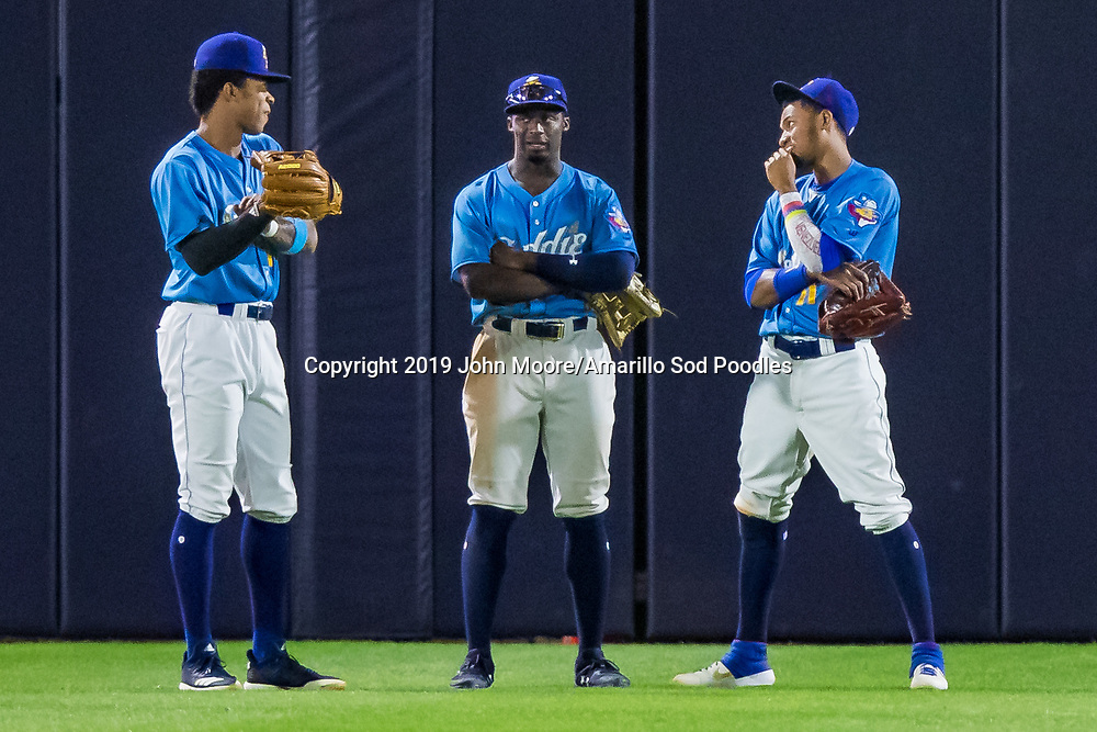 Amarillo Sod Poodles outfielder Buddy Reed (12), Amarillo Sod Poodles outfielder Taylor Trammell (7) and Amarillo Sod Poodles outfielder Edward Olivares (11) against the Tulsa Drillers during the Texas League Championship on Tuesday, Sept. 10, 2019, at HODGETOWN in Amarillo, Texas. [Photo by John Moore/Amarillo Sod Poodles]