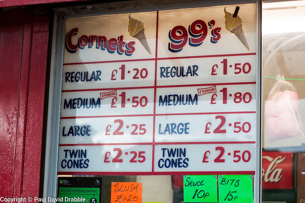 Ice Cream Cornets Price list at a traditional British seaside fast food stalls on the sea front at Cleethorpes Lincolnshire..1 July 2012.Image © Paul David Drabble