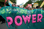 Balcombe, West Sussex. Site of Cuadrilla drilling. Demonstration against fracking 18.08.2013. Protesters hold a banner saying Power.