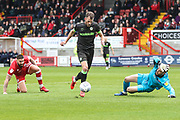 Forest Green Rovers Christian Doidge(9) rounds Glenn Morris of Crawley Town to equalise during the EFL Sky Bet League 2 match between Crawley Town and Forest Green Rovers at The People's Pension Stadium, Crawley, England on 6 April 2019.