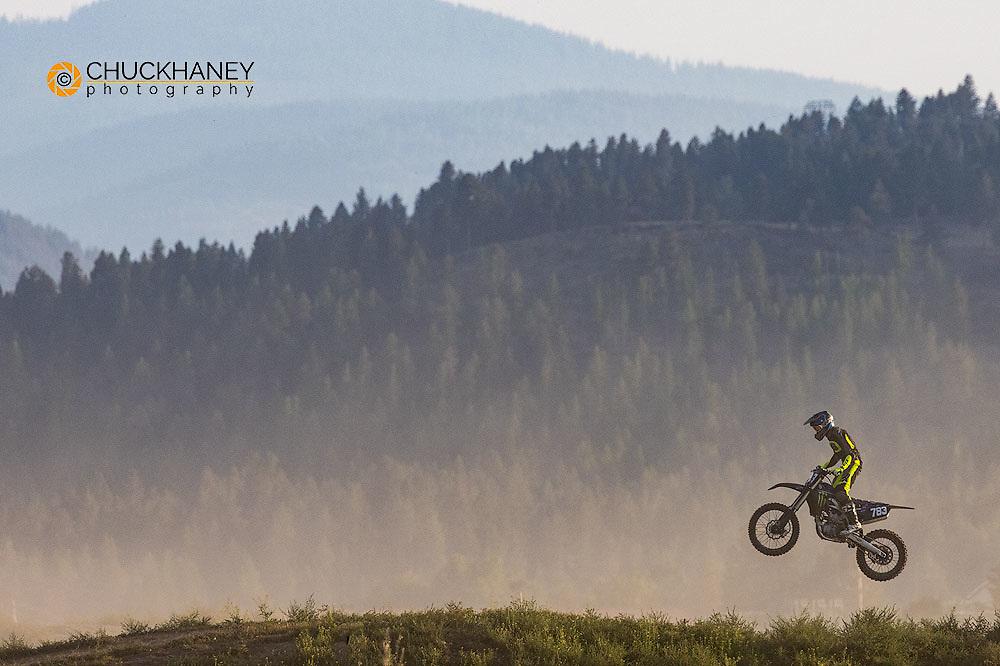 Dirt bike taking jumps in the Flathead Valley, Montana, USA