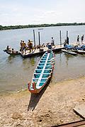 Crew loading into Asian Dragon racing boat at dock. Dragon Festival Lake Phalen Park St Paul Minnesota USA