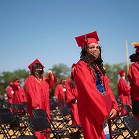 Taylor Foster holds her diploma after walking the stage Friday morning at the University of New Mexico-Gallup Spring 2021 commencement ceremony at Angelo DiPaolo Memorial Stadium in Gallup. Foster graduated with an Associate of Applied Science General Studies degree.