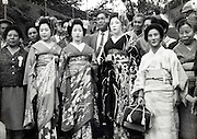 Japanese domestic tourism posing with Maiko girls Japan 1950s 1960s