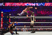 Mark Henry catches a competitor during a 20-man battle royal during WrestleMania on April 3, 2016 in Arlington, Texas.