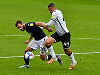 Football - 2020 / 2021 Sky Bet Championship - Swansea City vs Birmingham City - Liberty Stadium<br /> <br /> Mason Bennett of Millwall tackled by Ben Cabango of Swansea City