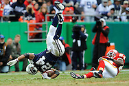 October 11, 2009:   Running back Marion Barber #24 of the Dallas Cowboys gets upended by defensive back Brandon Flowers #24 of the Kansas City Chiefs in the third quarter at Arrowhead Stadium in Kansas City, Missouri.  The Cowboys defeated the Chiefs in overtime 26-20...
