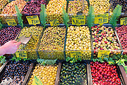 Green and black olives with Turkish lira price tickets for sale at food market in Kadikoy district Asian side Istanbul, Turkey