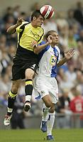 Photo: Aidan Ellis.<br /> Blackburn Rovers v Manchester City. The Barclays Premiership. 17/09/2006.<br /> City's Stephen Jordan beats Rovers David Bentley to the ball