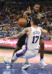 November 14, 2018 - Orlando, FL, USA - The Orlando Magic's Jonathon Simmons, top, drives through the Philadelphia 76ers' J.J. Redick (17) at the Amway Center in Orlando, Fla., on Wednesday, Nov. 14, 2018. (Credit Image: © Stephen M. Dowell/Orlando Sentinel/TNS via ZUMA Wire)