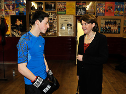 © Licensed to London News Pictures. 19/02/2013. Bristol, UK. Maria Miller (right), the Secretary of State for Culture Media and Sport, on a visit to the Empire Boxing Club in St Pauls, Bristol.  The Secretary of State is keen to build on the momentum of the Olympics and get more girls and women playing sport.  19 February 2013..Photo credit : Simon Chapman/LNP