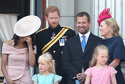 (Left to right) Duchess and Duke of Sussex, with Peter and Autumn Phillips, and daughters Isla and Savannah, on the balcony of Buckingham Palace, in central London, following the Trooping the Colour ceremony at Horse Guards Parade, as Queen Elizabeth II celebrates her official birthday.