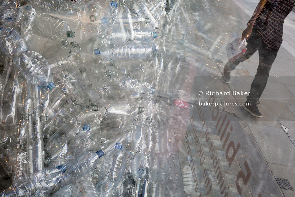 A detail of single-use plastic bottles displayed in a shop window on New Bond Street, on 22nd July, 2020, in London, England. The average Londoner buys more than three plastic water bottles every week -  175 bottles every year per person. And 7.7 billion plastic bottles are bought across the UK each year, resulting in substantial amounts of single-use plastic waste.