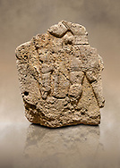 Photo of Hittite relief sculpted orthostat stone panel of Long Wall Limestone, Karkamıs, (Kargamıs), Carchemish (Karkemish), 900 - 700 B.C. Anatolian Civilizations Museum, Ankara, Turkey. The short-skirted figure with a dagger at the waist holds the gazelle from its hind legs.<br /> <br /> On a brown art background. .<br />  <br /> If you prefer to buy from our ALAMY STOCK LIBRARY page at https://www.alamy.com/portfolio/paul-williams-funkystock/hittite-art-antiquities.html  - Type  Karkamıs in LOWER SEARCH WITHIN GALLERY box. Refine search by adding background colour, place, museum etc.<br /> <br /> Visit our HITTITE PHOTO COLLECTIONS for more photos to download or buy as wall art prints https://funkystock.photoshelter.com/gallery-collection/The-Hittites-Art-Artefacts-Antiquities-Historic-Sites-Pictures-Images-of/C0000NUBSMhSc3Oo