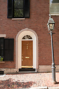 Elegant front door of a home in W. Cedar Street in the Beacon Hill historic district of Boston, Massachusetts, USA