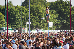 © Licensed to London News Pictures . 09/06/2013 . Heaton Park , Manchester , UK . A man climbs a temporary flagpole above the crowds . Day 2 of the Parklife music festival in Manchester on Sunday 9th June 2013 . Photo credit : Joel Goodman/LNP