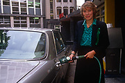 Conservative MP, Virginia Bottomley fills a car with unleaded fuel during Lead free Petrol Week in September 1989, London England. Virginia Hilda Brunette Maxwell Bottomley, Baroness Bottomley of Nettlestone, PC, DL née Garnett, 1948 is a British Conservative Party politician. She was a Member of Parliament MP in the House of Commons from 1984 to 2005 and raised to the peerage in 2005.