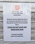 MERTHYR TYDFIL, WALES - 20 APRIL 2020 - Local Salvation Army charity shop displays a closure sign on its shutters due to the covid-19, corona virus epidemic lockdown.