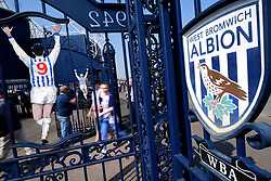 West Bromwich Albion fans touch the Jeffrey Astle gates on the way into the Hawthorns