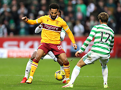 Motherwell's Jordan Roberts (left) and Celtic's Joao Pedro Jota battle for the ball during the cinch Premiership match at Fir Park, Motherwell. Picture date: Saturday October 16, 2021.