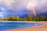 Evening light and rainbow over the blue Pacific from Tunnels Beach, Kauai, Hawaii