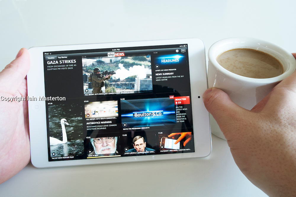 Reading SKY news digital edition on an iPad mini tablet computer