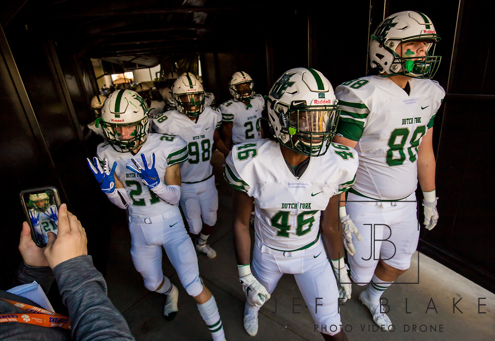 Dutch Fork Silver Foxes players head to the field before the game against the Dorman Cavaliers in the Class AAAAA State Championship Game at Williams-Brice Stadium in Columbia, SC. Dutch Fork wins their 4th straight state championship at Williams Brice Stadium. Photos ©JeffBlakePhoto.com