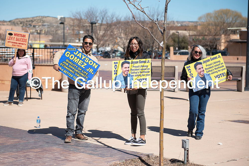 Jayson Gomez, left, campaigns with his girlfriend Kyra Spencer, center, and sister Dey Gomez outside the McKinley County Courthouse Tuesday, March 3 as voters cast their ballots for the 2020 Municipal Officer Election in Gallup.