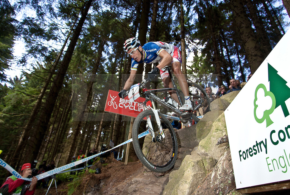 © licensed to London News Pictures. Pickering, UK.  20/05/11. Julien Absalon (France) takes on the Worry Gill rock drop during the men's elite race. 2011 UCI Mountain Bike Cross-Country World Cup at Dalby Forest..Please see special instructions for usage rates. Photo credit should read: Reuben Tabner