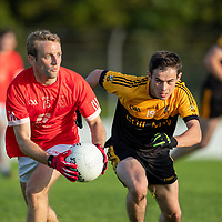 Eire Og's Kevin Brennan is chased by Coolmeen's Mark Meaney
