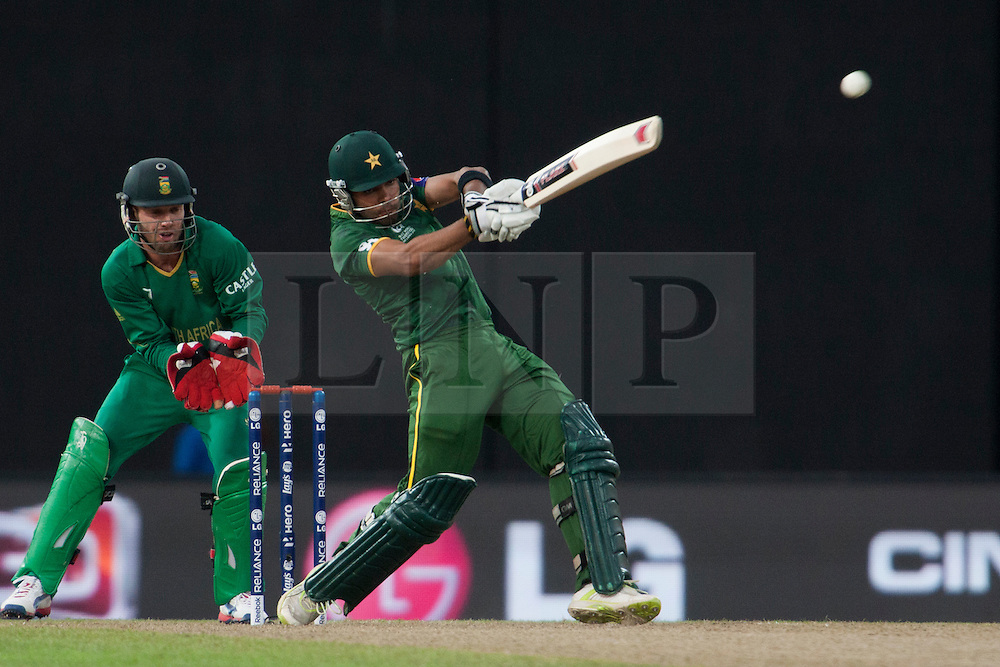 © Licensed to London News Pictures. 28/09/2012. Pakistani batsmen Umar Akmal plays a powerful shot during the T20 Cricket World cup match between South Africa Vs Pakistan at the R.Premadasa Cricket Stadium,Colombo. Photo credit : Asanka Brendon Ratnayake/LNP