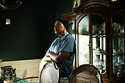 ALABASTER, AL – JUNE 9, 2020: Annie Kynard-Hackworth stands in the dining room she once shared with her late husband, Herman Hackworth, who served honorably in the Korean War. Following her husband's diagnosis with Lewy Body Disease, a rare form of dementia, Kynard-Hackworth transitioned her veteran husband to Bill Nichols Veterans Home in Alexander City. While there, Hackworth passed away from complications due to COVID-19. CREDIT: Bob Miller for The Wall Street Journal<br /> VETVIRUS