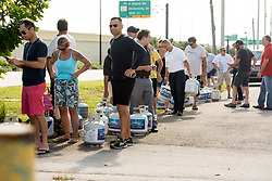 September 6, 2017 - Davie, Florida, U.S - Florida residents line up to get their propane cylinders filled in preperation for hurricane Irma, in Davie, Fla. Florida Governor, Rick Scott, declared a state of emergency for all counties in Florida on Monday, in enticipation of possible impact of category five Hurricane Irma later this week. (Credit Image: © Orit Ben-Ezzer via ZUMA Wire)