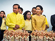 09 JUNE 2016 - BANGKOK, THAILAND:  Gen PRAYUT CHAN-O-CHA, left, the Prime Minister of Thailand and his wife, NARAPORN CHAN-O-CHA, wait to present Buddhist monks with alms in front of the Grand Palace. Thailand marked 70 years of the reign of Bhumibol Adulyadej, the King of Thailand, with a special alms giving ceremony for 770 monks in front of the Grand Palace in Bangkok. The King, also known as Rama IX, ascended the throne on 9 June 1946. He is the longest serving monarch in Thai history and the longest serving monarch in the world today. He is revered by most Thais and is widely seen as a unifying figure in the country.    PHOTO BY JACK KURTZ