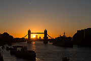 Sunrise behind Tower Bridge and HMS Belfast on the River Thames in London, England on February 12, 2018 following a very cold night in the capital with temperatures dropping to below zero degrees in some area of the city.