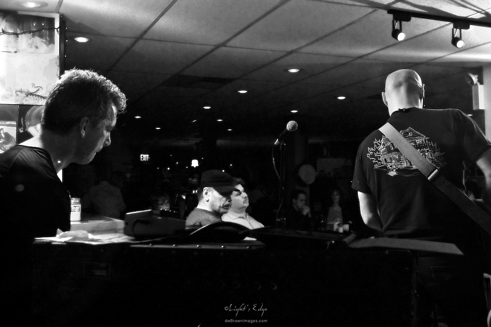 Looking into The Bus Stop Music Cafe at Brooke Hendricks (keyboards) and Bob Trimble (guitar) of The Sea Turtles.