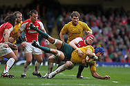 Australia's Nathan Sharpe is tackled by Alun Wyn Jones of Wales. Invesco Perpetual series, autumn international, Wales v Australia at the Millennium Stadium in Cardiff on Sat 6th Nov 2010.  pic by Andrew Orchard, Andrew Orchard sports photography,