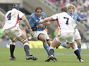 Twickenham, Surrey, 9th March2003, Six nations International Rugby,  RFU Stadium, England, [Mandatory Credit; Peter Spurrier/Intersport Images]<br /> Photo Peter Spurrier<br /> 09/03/2003<br /> RBS Six Nations Rugby England v Italy<br /> Italian flanker Andrea De Rossi see's the gap close as Danny Grewcock No,4 and Richard Hill close in for teh tackle.