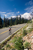 Young man cycling in Mount Rainier National Park, WA.<br />