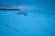 Lake Superior, the largest of the five North American Great Lakes, is covered in late winter ice in this twilight view from Whitefish Point on the Upper Peninsula of Michigan.
