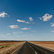 Straight endless road in the desert of Northern territories.