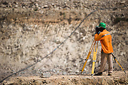 A mine worker surveys at the Youga gold mine near the town of Youga, approximately 205 km southeast of Burkina Faso's capital Ouagadougou on Tuesday April 28, 2009...