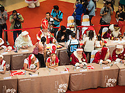 """17 SEPTEMBER 2015 - BANGKOK, THAILAND: Santa Clauses at the World Santa Claus Congress. The """"wai"""" is the traditional Thai greeting. Twenty-six Santa Clauses from around the world are in Bangkok for the first World Santa Claus Congress. The World Santa Claus Congress has been an annual event in Denmark since 1957. This year's event, hosted by Snow Town, a theme park with a winter and snow theme, hosted the event. There were Santas from Japan, Hong Kong, the US, Canada, Germany, France and Denmark. They presented gifts to Thai children and judged a Santa pageant. Thailand, a Buddhist country, does not celebrate the religious aspects of Christmas, but Thais do celebrate the commercial aspects of the holiday.    PHOTO BY JACK KURTZ"""