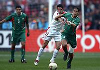 Fotball<br /> African Nations Cup 2004<br /> Afrika mesterskapet 2004<br /> Foto: Digitalsport<br /> NORWAY ONLY<br /> <br /> FINAL - 040214 <br /> TUNISIA v MOROCCO <br /> TALAL EL KARKOURI (MAR) / SANTOS (TUN) *** Local Caption *** 40001044