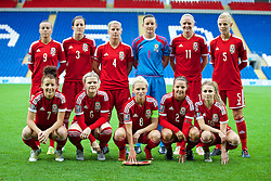 CARDIFF, WALES - Tuesday, August 21, 2014: Wales' players line up for a team group photograph before the FIFA Women's World Cup Canada 2015 Qualifying Group 6 match at the Cardiff City Stadium. Back row L-R: Natasha Harding, Nicola Cousins, Kylie Davies, Nicola Davies, Helen Bleazard, Sophie Ingle. Front row L-R: Angharad James, Michelle Green, captain Jessica Fishlock, Loren Dykes, Sarah Wiltshire. (Pic by David Rawcliffe/Propaganda)