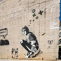 Stenciled street art by prominent artist xoooox in Berlin Germany