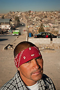 A young man dressed in gang colors, in one of the poorest slums of Juarez, Mexico January 15, 2009. The ongoing drug war has already claimed more than 40 people since the start of the year. More than 1600 people were killed in Juarez in 2008, making Juarez the most violent city in Mexico.