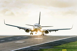 © Licensed to London News Pictures. 23/09/2021. Leeds UK. A Ryanair aircraft arriving from Palma struggles to land in strong winds at Leeds Bradford International Airport this morning. Photo credit: Andrew McCaren/LNP