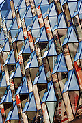 A faceted glass diamond shaped façade gives a modern face to an old 1960s building. Oxford street, London. <br /> <br /> Architect: Future Systems