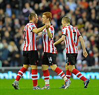 20111226: LONDON, UK - Barclays Premier League 2011/2012: Sunderland vs Everton.<br /> In photo: Jack Colback of Sunderland AFC (C) celebrates scoring his side's first goal with team mate Phillip Bardsley (L)..<br /> PHOTO: CITYFILES